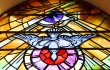 1024px-Stained_glass_Holy_Family_Church_Teconnaught_September_2010_crop